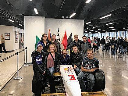 Urbana FFA students who visited the Indianapolis Speedway Museum included, back row from left, Ashlyn Dunn, Janie Wallace, Nick Crumley, Zack Collins, front row from left, Connor Trawick, Olivia Maurice, Kirstin Lewis, Mackenzie Bean and Jesse Craig.