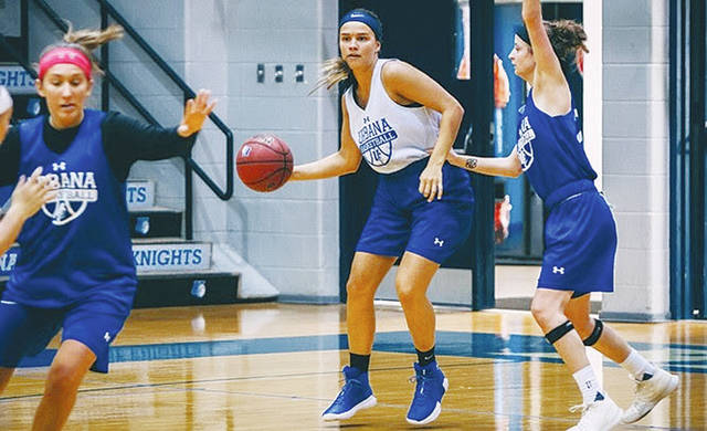 Urbana University's Erin Morrow dribbles during a recent practice.