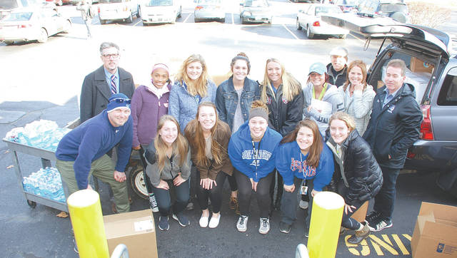 Volunteers from Urbana University's women's soccer team and their coaches load collected donations for the Alicia Titus Memorial Peace Fund onto a truck on Monday. The donations will be shipped to Florida and from there to Puerto Rico for Hurricane Maria relief, an idea inspired by a UU student with family in one of the hardest hit parts of the island.