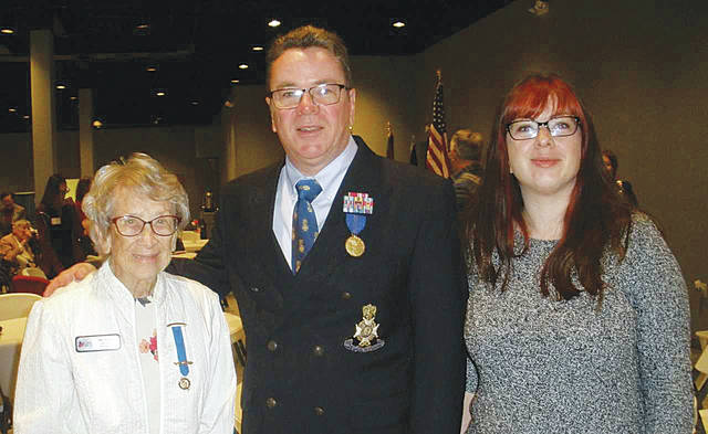Col. Robert D. Pollock USAF (ret.) presented a talk about World War II to Veterans, DAR members and guests. He is pictured with DAR members Mary Pollock, his mother, and Alexandra Boyle, his daughter.