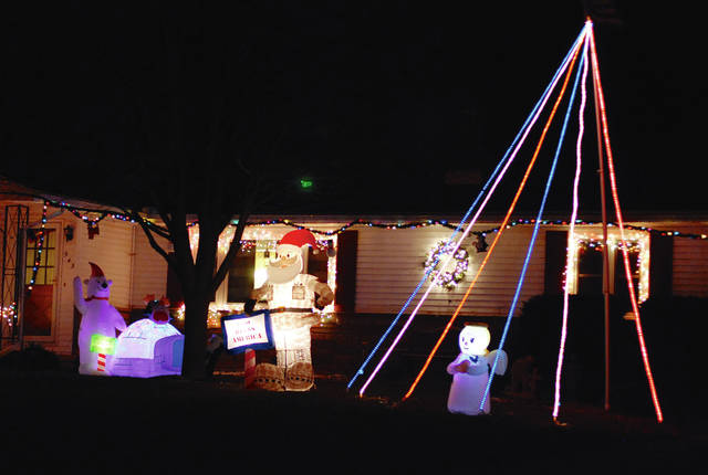 This house on Wooddale Drive in Urbana is one of many area residences lit up for the Christmas season.