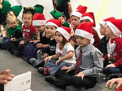 On Dec. 14, the Champaign Family YMCA hosted its annual Preschool Christmas Program, featuring the Y's 56 preschool students (ages 3-5). The YMCA lobby was packed with parents and grandparents for the program, during which many carols were sung. Shown are children ready to perform one of the songs.