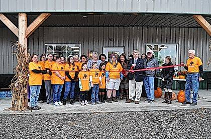 The Champaign County Chamber hosted a ribbon-cutting Oct. 28 at the Champaign County Animal Welfare League, 3858 state Route 56, just east of Mutual. In the photo are, front from left, Hayden West, Hagen Dyer, Avery Wolf, Tiger Franks, Kay McOwen, Ron Tompkins, Steve Massie, Chamber Executive Director Lydia Hess, Karla Smith, Gene Newcomer, 2nd row from left, Virginia Palmer, Masie Decker, Carol Souza, Debra Walters, Jana Weithman, Stephanie Huffman, Ginny Powell, Zack, Leavell, Alyssa Spitler, Dr. Amanda Wolf, 3rd row from left, Chelsea Palmer, Casey Palmer, Mona Newcomer, Elaine Massie, Korie West, 4th row from left, 4th row, Nancy Bendum and Judy Schmid.