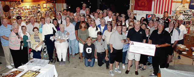 """The Champaign County Shrine Club recently celebrated quite a milestone in one of their major fund-raisers for the """"Shriner Hospitals for Children."""" The collecting of aluminum cans, since 1985, has now allowed the local Shrine Club to donate over $800,000 to the hospitals. The Shriners send a big """"THANK YOU"""" to the residents of Champaign County who have saved and donated their aluminum cans, this could not have been possible without your help! KEEP THE CANS COMING!"""
