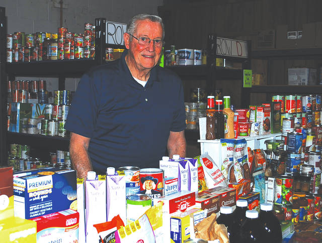 Bill Miller, president of the Champaign County Memorial Foundation, delivers food to the Oasis of Mercy food pantry at St. Michael's Hall.