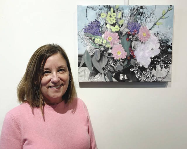 "Lin Giampetro poses with her floral creation in ""Bad Art by Good People"" for 2018."