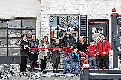 The Champaign County Chamber hosted a ribbon-cutting Feb. 8 at McNeely's Auto Repair, 331 N. Main St., Urbana, to recognize new management at the business. From left are Marcia Bailey, Lesli Beavers, Hannah Tukesbrey Kilbride, Chamber Executive Director Lydia Hess, Eric McNeely, owner, Kirk McNeely, Tori McNeely, Christian McNeely and Josh Decker.