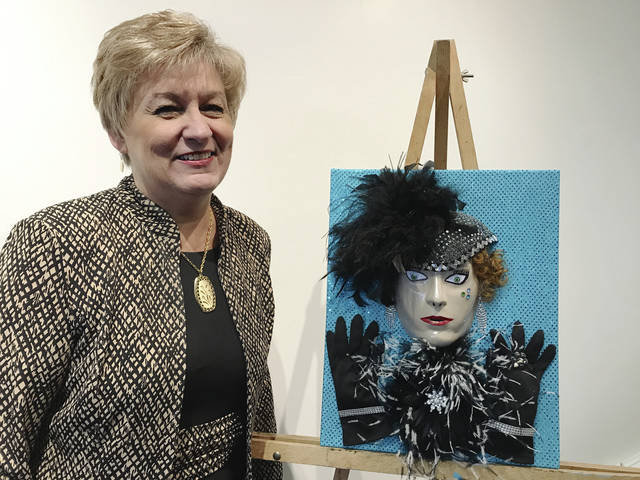 "Nancy Zerkle is shown with her fancy attempt to create ""Bad Art"" for the annual fundraiser."