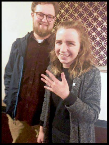 Sara Thornsberry and Parker Bartlett show the ring after the proposal at The Gloria.