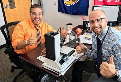 Assistant Principal Nick Guidera and Principal Chad Lensman are excited to receive a 3D printer from Learning Blade.
