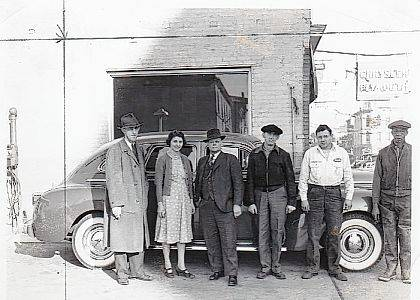This is a November 1940 photo of the Urbana Motor Sales, A. T. Pickrell proprietor. The business was located at the NW corner of W. Market and S. Main streets in Urbana. Later Mr. Pickrell moved his business to a location on N. Main Street. In the photo (left to right) are A.T. Pirkrell, Marjory Blair, Hugh Brackney, Earl Hall, unidentified person and Sam McGregor. Currently this building at 122 S. Main St. is the location of PB&J on Main (vintage & collectibles). The Champaign County Historical Society thanks Donna Lu (Pickrell) Ward for sharing this photo of her father. <em>The Champaign County Historical Society is an all-volunteer, not-for-profit organization that preserves, protects, archives and displays the artifacts that tell Champaign County's history. The society operates on donations and dues and has a free public museum of history at East Lawn Avenue in Urbana</em>
