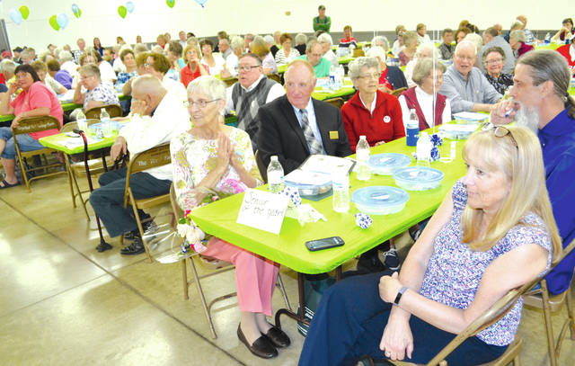 "Arletha Joy ""Jo"" Frasure was named Champaign County's Outstanding Senior Citizen of the Year on Tuesday at the county fairgrounds. Frasure was joined by six of her classmates from Urbana High School's class of 1954, as well as members of the Urbana Champaign County Senior Center, for a full day of activities that began with a senior support services expo, followed by lunch, then entertainment by the UCCSC Line Dancers, The Dancing Dolls and the Urbana High School Show Choir. Urbana Mayor Bill Bean read a proclamation declaring May as Older Americans Month and thanked Frasure for her service on the UCCSC Board and the Oak Dale Cemetery Board, and for her volunteer service at Vancrest of Urbana, Sycamore House, the Community Thrift Store and elsewhere."