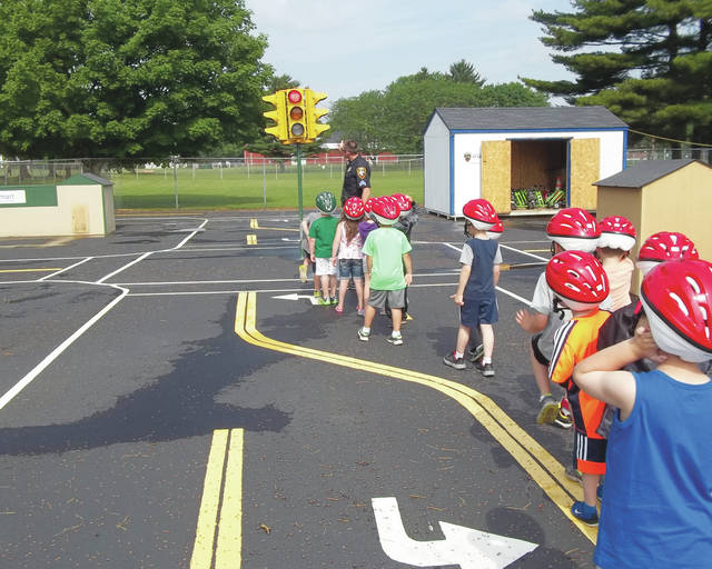 This photo shows children learning about stoplight safety during last year's Safety Town.