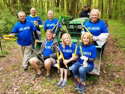 These Realtors from Choice Properties recently volunteered to help maintain the Cherokee Trail at Indian Lake State Park. Sitting L to R: Dale Frymyer, Paige Duff, Monica Margerum. Standing L to R: Woody Gordon, Randy Wax, Jill MacDonald, Dave Clay (on the tractor), Rosie O'Boyle