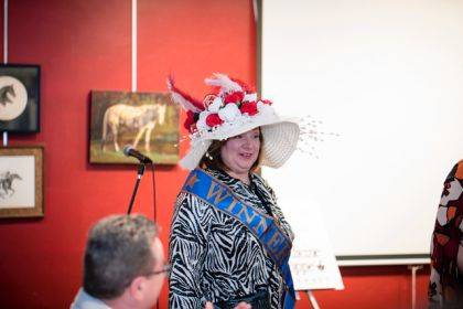 Catherine Harris won Best Hat recognition at the Champaign County Arts Council's Annual Celebration of the Arts, which had a Kentucky Derby theme.