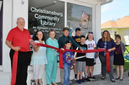 The Champaign County Chamber hosted a ribbon-cutting June 6 at the new Christiansburg Community Library, an outreach site of The St. Paris Public Library. The new library is at 203 N. Main St., Christiansburg. From left are Jeff McCulla, Patricia Cook-Geuy, Freda Roesser, Floyd Butts, Gavin Bolen, Brantlee Oburn, Brady Olson, Rylee Olson, Nicole Rush, director of the St. Paris and Christiansburg libraries, and Chamber Executive Director Lydia Hess.