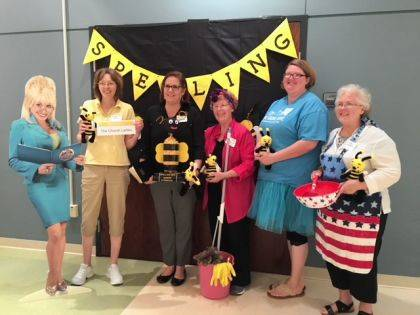 "The winning spellers of the ""Church Ladies"" team, posing here with ""Dolly Parton,"" are Leslie Runion, Karen Montgomery, Gladene Johnson, Jennifer McCombs and Judy Hughes."