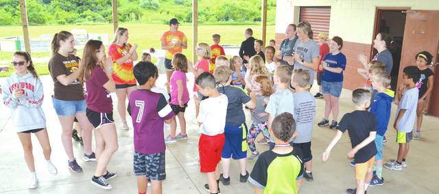 Campers and counselors at the Champaign Family YMCA's summer day camp begin their morning by singing songs before splitting into activity groups on June 8. Camps are running now through Aug. 10, with each week featuring a traditional camp for ages 6-12 and two specialty camps, such as photography or animal adventures, and concluding with a field trip. For more information or to register, visit www.champaignfamilyymca.org.