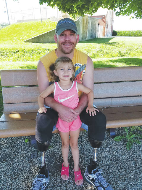 Andy Smith and his daughter, Arianna, enjoy an afternoon at the park.