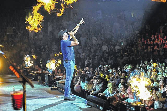 Luke Bryan stands onstage during the Calgary Stampede concert on July 14.