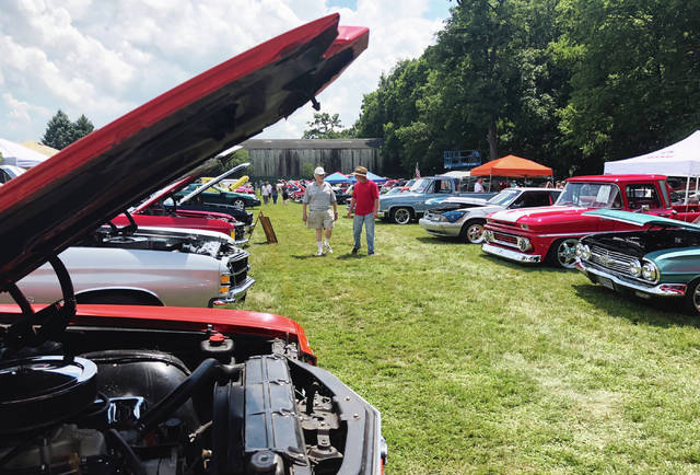 The Champaign Cruisers' annual July 4 Firecracker Car and Truck Show was the place to be on Wednesday. Shady spots were in high demand on the lot behind Skelley Lumber where the classic car and truck entries were displayed. Temperatures were above 90 and the heat index was 98 degrees. The show precedes the Urbana Rotary Chicken Barbecue and Fireworks each July 4 at Grimes Field.
