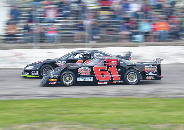 Mike Ward (61) of Urbana and Josh Smith of Quincy battle it out in the Nagel Excavating Late Models. Smith leads the points going into today's Tony Rigney Memorial.