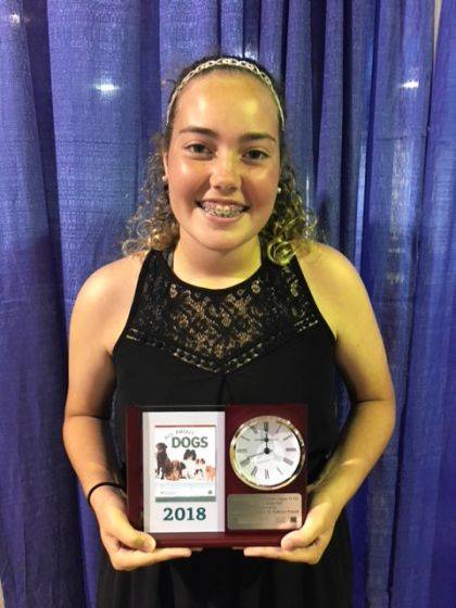 "Anna Selvaggio won the Clock Trophy for her ""All About Dogs"" project at the state fair. While at the state fair she was also awarded an Outstanding of the Day ribbon for her Sewing for Middle School project."