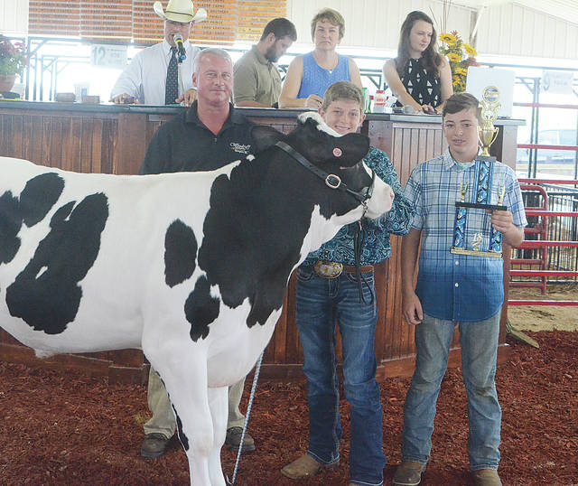 Austin Olejniczak's Rookie Showmanship Dairy Feeder sold for $500 to the Ice Cream Parlor of West Liberty.