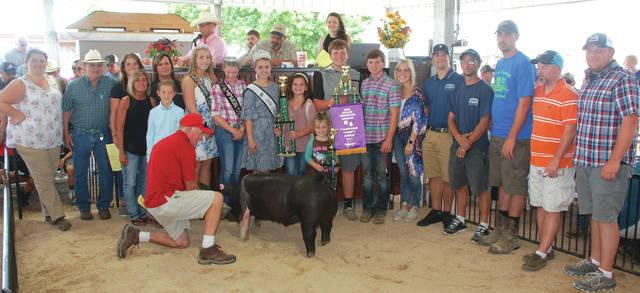Oliver McGuire's Grand Champion Overall Market Barrow was sold to a syndicate for $2,500.