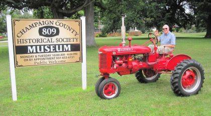 Joe Morrow drives the restored 1943 McCormick-Deering Farmall BN he and his wife, Cecily, donated to the Champaign County Historical Society. The society's newest acquisition will be featured at the East Lawn Avenue museum this Sunday during regular Sunday hours of 1-4 p.m.