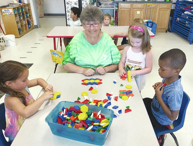Linda Coffman is shown with children in the YMCA Mechanicsburg preschool program
