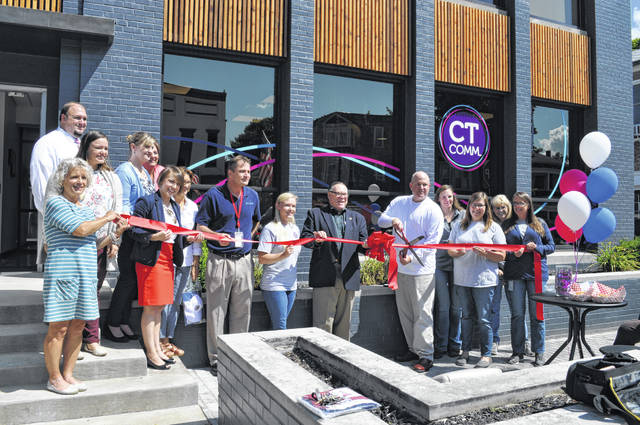 The Champaign County Chamber hosted a ribbon-cutting Aug. 23 at the grand re-opening of CT Comm at 126 Scioto St., Urbana. From left are Vicki Deere-Bunnell, Hannah Kilbride, Brandon Nichols, Carissa Luza-Sellman, Stacey Reese, Lydia Hess, chamber executive director, Ken Ferrell, Tiffany Ebersold, CFO, Mayor Bill Bean, Tim Bolander, CEO, Angie Robinson, Emily Huffman, Debbie Millner and Melanie Adams.