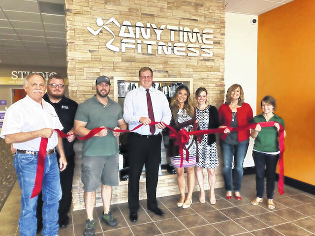 The Champaign County Chamber hosted a ribbon-cutting Sept. 14 at the grand opening of Anytime Fitness, 1637 Scioto St., Urbana. From left are Larry Krugh, Ryan Krugh, David Sabo, owner, Zac Fiely, Whitney Jarzab, club director, Sandrine Lusch, manager, Nita Wilkinson and Lydia Hess, chamber executive director.