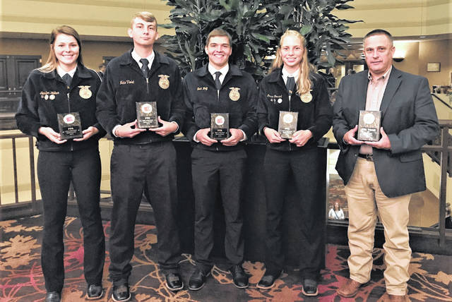 From left are championship Mechanicsburg Livestock Team members Jennifer Wallace, Nate Violet, Noah Wolf and Grace Forrest with Coach Kevin Neer.