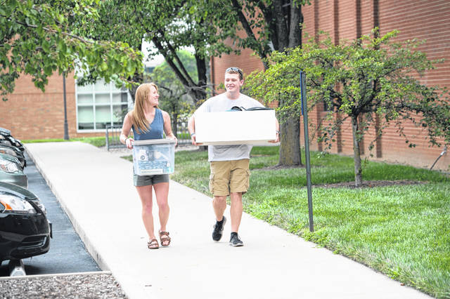 West Liberty-Salem graduate Logan Cole, right, is a freshman this year at Cedarville University. Pictured with him is his sister Leah, a fellow Cedarville student, as the duo prepares for this school year.