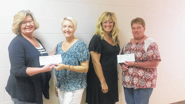 The Urbana Women of the Moose recently presented checks to local teachers for classroom needs. From left are Trish Foster, Teachers Leffel and Newman and Kim Rowland. August chairman Trish Foster and Jr. Grad Regent Kim Rowland spent the month doing raffles and 50/50 drawings to raise money for a program dear to them. Leffel and Newman teach at the Educational Service Center in Champaign County. Leffel teaches Life Transition and Newman teaches Preschool. Each teacher was thanked for doing great jobs and each was presented a $400 donation.