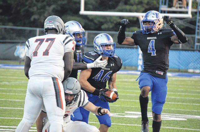 Urbana University's L.A. Kelly (46), Tobias Hailey Jr. (11) and DeArmon Lewis (4) celebrate Kelly's fumble recovery for the Blue Knights' defense during the first quarter of Thursday's contest with West Virginia Wesleyan.