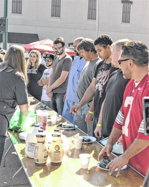 The 12th Annual Simon Kenton Chili Cook-Off Festival and Hoopla Parade drew a crowd to downtown Urbana on Saturday. In photo, contestants line up for the pepper eating contest.