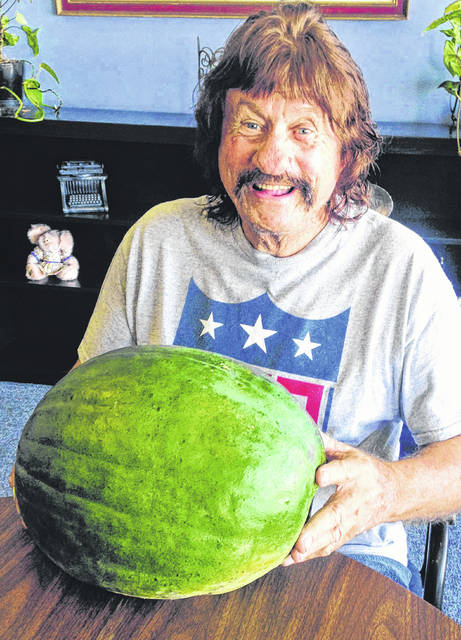 Stan Gilliam Sr. gets a tad excited about what his 731 James Ave. garden grows. He wanted to share with readers this huge watermelon, the largest in his current collection. Just took a couple applications of fertilizer, he said.