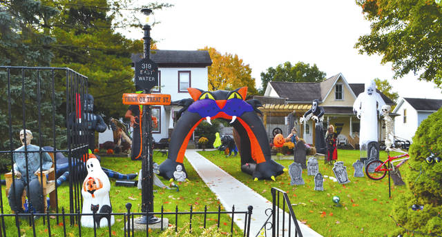 The house at 319 E. Water St. has been renamed Trick or Treat Street for Halloween, with a spooky collection of ghosts, gravestones and other creepy characters decorating the yard. Just up the street at 211 E. Water St. is another haunting attraction for local trick or treaters to visit on their trek around the neighborhood. Beggar's Night is 6-8 p.m. today for Urbana, North Lewisburg, Woodstock, Mechanicsburg, Cable, Christiansburg, Mingo and Mutual.