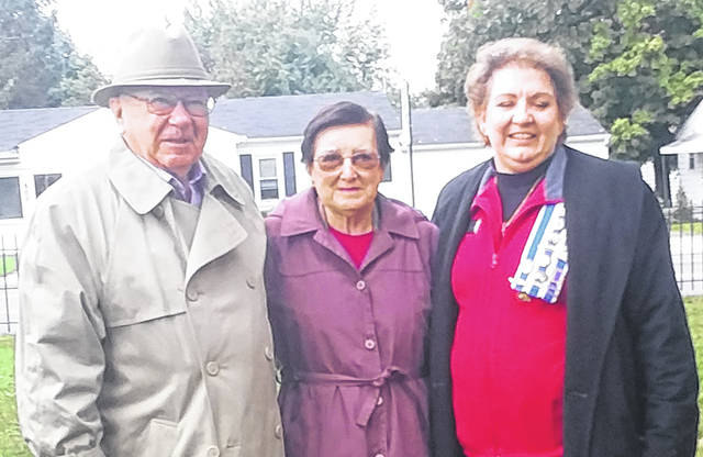 Betty Driever, center, has been made an Urbana DAR Chapter honorary regent. A tree will be planted on the grounds of the Champaign County Historical Society in her name. Pictured with her are her husband, Lou, and Urbana Regent Kim Snyder.