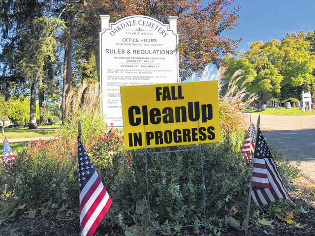 As the posted signs indicate, Oak Dale Cemetery in Urbana is undergoing one of two seasonal cleanups. Fall Cleanup is underway Oct. 15 through Nov. 21. During this phase, grave decorations are gathered, dead trees are removed and other organic debris is gathered and disposed. A storm packing high winds on Saturday complicated the scene by knocking down limbs on the cleanup already in progress.