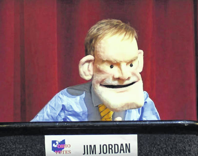 A campaign ad for Janet Garrett shows a puppet of U.S. Rep. Jim Jordan, R-Urbana, the congressman Garrett is aiming to unseat in November.