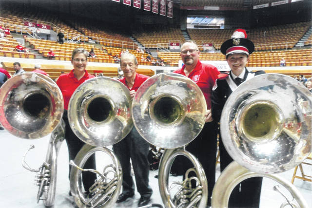"The two pairs of Ohio State father-daughter Script Ohio ""i-dotters"" are (from left) Jan Duga and her father Jules Duga, and West Liberty residents Greg Hostetler and his daughter, who is a current OSUMB member, Lindsay Hostetler."