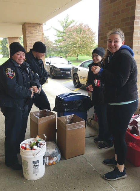 Urbana Police Officers Logan Dunn and Kerrie Kimpel, left, along with Kroger Pharmacist Erin Zurlinden and Technician Shawna Lambert participate in the Drug Enforcement Agency's National Prescription Drug Take-Back Day on Oct. 27. The team collected 38.4 pounds of old and unused prescription medications during the event. The drugs were turned over to the DEA for disposal.