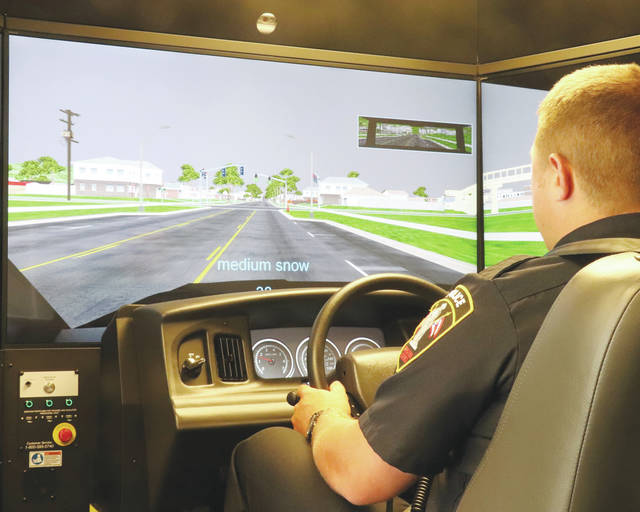 Urbana Police Officer Logan Dunn drives through a simulated scenario Oct. 3 as part of an emergency driving training session. The driving simulator was provided by the Ohio Peace Officer Training Academy for the Urbana Police Division as well as other local law enforcement agencies.