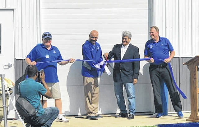 The Champaign County Chamber hosted a ribbon-cutting Oct. 6 at the new athletic facility at Urbana University. From left are Urbana Mayor Bill Bean, Dr. Christopher Washington, executive vice president and provost, Dr. David Decker, president of Franklin University, and Larry Cox, UU executive athletic director.