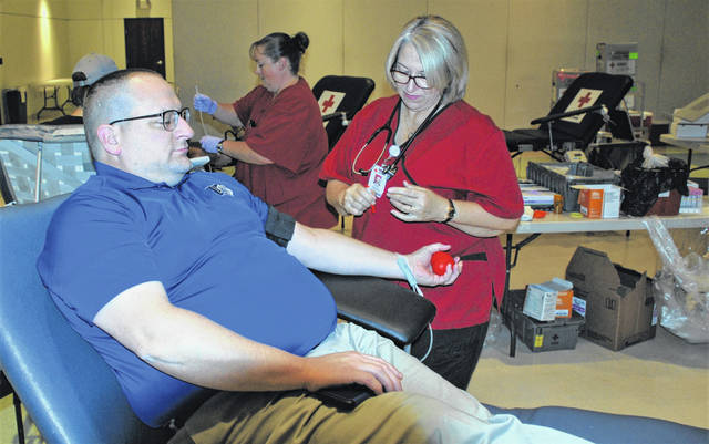 Urbana University's Nick Christian participated in the American Red Cross blood drive on Tuesday at the university student center. The Red Cross visited the campus with its traveling unit and staff. Pictured with Christian is Cindy Minix of the Red Cross. The blood drive was in partnership with Urbana University Student Health Services.