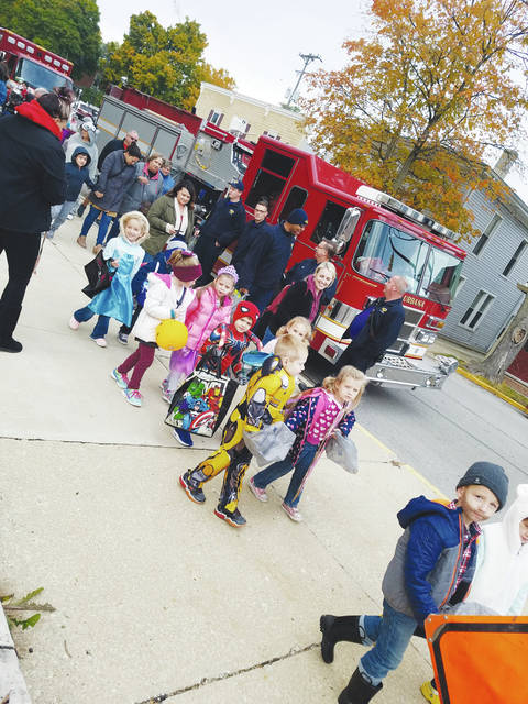 Center for Creative Childcare had its annual Dress-Up Parade in downtown Urbana on Oct. 26. The Urbana Fire Division had fire trucks at the event, and the Police Division helped children walk the parade route and blocked traffic. The annual community Beggar's Night in Urbana is Wednesday, Oct. 31 from 6-8 p.m.
