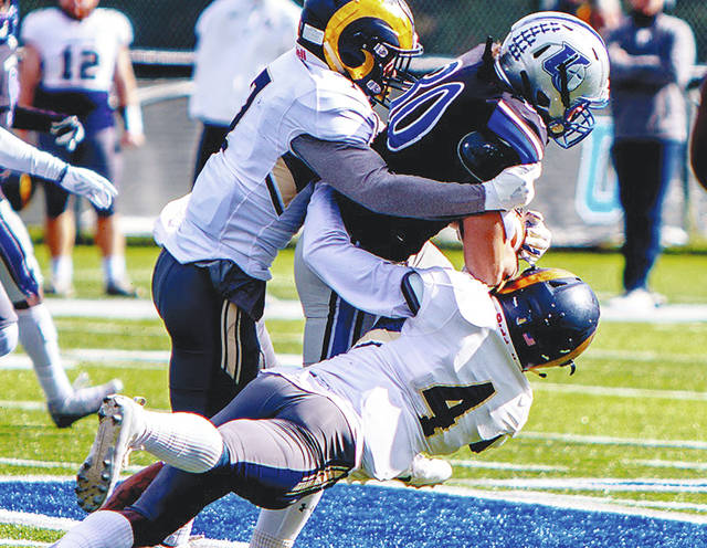 UU's Bailey Wallen (30) attempts to break a tackle during Saturday's game with visiting Shepherd.